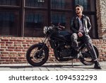 handsome bearded biker with... | Shutterstock . vector #1094532293