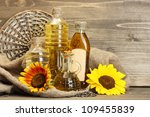 oil in bottles  sunflowers and... | Shutterstock . vector #109455839