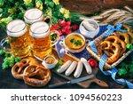 bavarian sausages with pretzels ... | Shutterstock . vector #1094560223