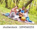 group of friends enjoying... | Shutterstock . vector #1094560253