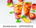 peach ice tea in a glass with... | Shutterstock . vector #1094563016