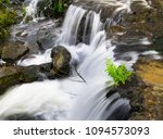 water falls in the river mi o | Shutterstock . vector #1094573093