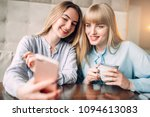young woman shows photos to her ... | Shutterstock . vector #1094613083