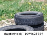 old car tires lying among the... | Shutterstock . vector #1094625989