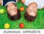 two boys lying down on fresh... | Shutterstock . vector #1094628176