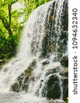 small waterfall in public... | Shutterstock . vector #1094632340