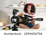 happy black girl at home... | Shutterstock . vector #1094656706
