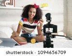 happy girl at home speaking in... | Shutterstock . vector #1094656709