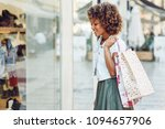 young black woman in front of a ... | Shutterstock . vector #1094657906