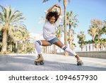 smiling black woman on roller... | Shutterstock . vector #1094657930