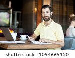 young economist with documents... | Shutterstock . vector #1094669150