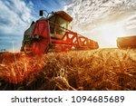 combine harvest in the golden... | Shutterstock . vector #1094685689