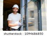 handsome young man installing... | Shutterstock . vector #1094686850