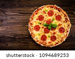 pizza pepperoni on wooden... | Shutterstock . vector #1094689253