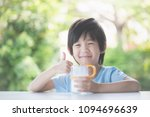 portrait of a cute asian child... | Shutterstock . vector #1094696639