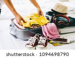 woman packing travel bag for... | Shutterstock . vector #1094698790