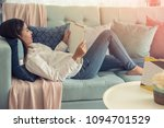 young woman sitting on sofa and ... | Shutterstock . vector #1094701529