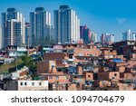 Contrast between the modern buildings and Paraisopolis, one slum of Sao Paulo in Brazil. Example of gentrification in the city.