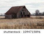 Abandoned Barn In A Field In...