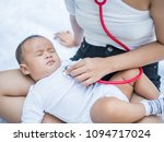 mom listen to baby heart with... | Shutterstock . vector #1094717024