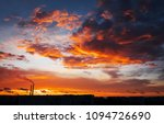 colorful magic sunset. roofs of ... | Shutterstock . vector #1094726690