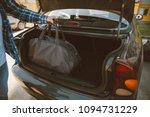 man put bags to car trunk. car... | Shutterstock . vector #1094731229
