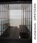 Small photo of cells in an Old Grunge Prison seen through Jail Bars