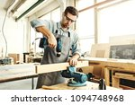concentrated young carpenter... | Shutterstock . vector #1094748968