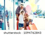 happy family walking along the... | Shutterstock . vector #1094762843