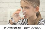 child drinking water in kitchen ... | Shutterstock . vector #1094804000