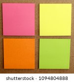 Small photo of sheet of pink, yellow, orange and green paper, stuck to the wall of m. It is used to write notes, messages, incorporate text.