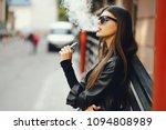 stylish girl smoking an e... | Shutterstock . vector #1094808989
