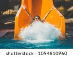joyful woman going down on the... | Shutterstock . vector #1094810960