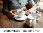 girl in a cafe drinking coffee... | Shutterstock . vector #1094817740
