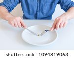 hungry man feeling sad in front ... | Shutterstock . vector #1094819063
