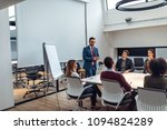 group of coworkers having a... | Shutterstock . vector #1094824289