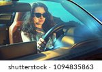 pretty  young woman driving her ... | Shutterstock . vector #1094835863