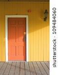 yellow house with red door | Shutterstock . vector #109484060