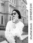girl in sunglasses pose on...   Shutterstock . vector #1094855144