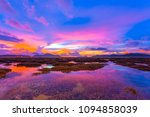 scenery sunrise above the coral ... | Shutterstock . vector #1094858039
