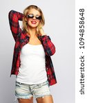a modern young woman in a plaid ... | Shutterstock . vector #1094858648