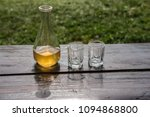 Small photo of Sweet yellow honey wine meade on the wooden table. Ready to drink.