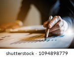 an accountant man holding pen... | Shutterstock . vector #1094898779