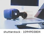 virtual reality goggles on desk ... | Shutterstock . vector #1094903804