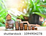 Small photo of house model on coins saving set decrease down for concept interest rate low for home loan financial and mortgage