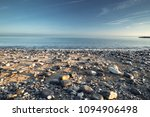 scenic stony beach in morning... | Shutterstock . vector #1094906498