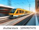 high speed orange train in... | Shutterstock . vector #1094907470