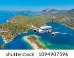 airplane is flying over amazing ... | Shutterstock . vector #1094907596