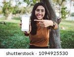 hands holding   using... | Shutterstock . vector #1094925530