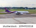 Small photo of SINGAPORE - July 07, 2017 : Aircraft of THAI AIRWAY are ready to take off in runway takeoff at Changi International Airport, Singapore